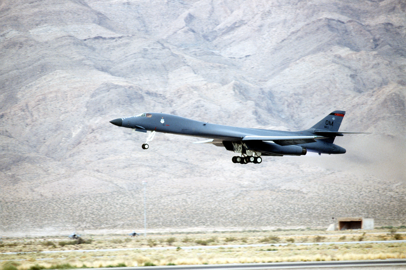 B-1B Lancer bomber from the 34th Bomb Squadron, 366th Wing, Ellsworth Air Force Base, South Dakota, takes off from this Nevada base during GUNSMOKE 95. Exact Date Shot Unknown