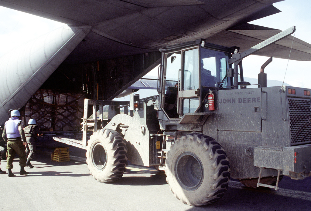 A United Nations ground crew member uses a M13K rough terrain forklift to unload a C-130 Hercules loaded with humanitarian relief supplies. The three-year-old relief effort has been able to resume its missions after a five month hold due to aircraft receiving ground fire over Sarajevo