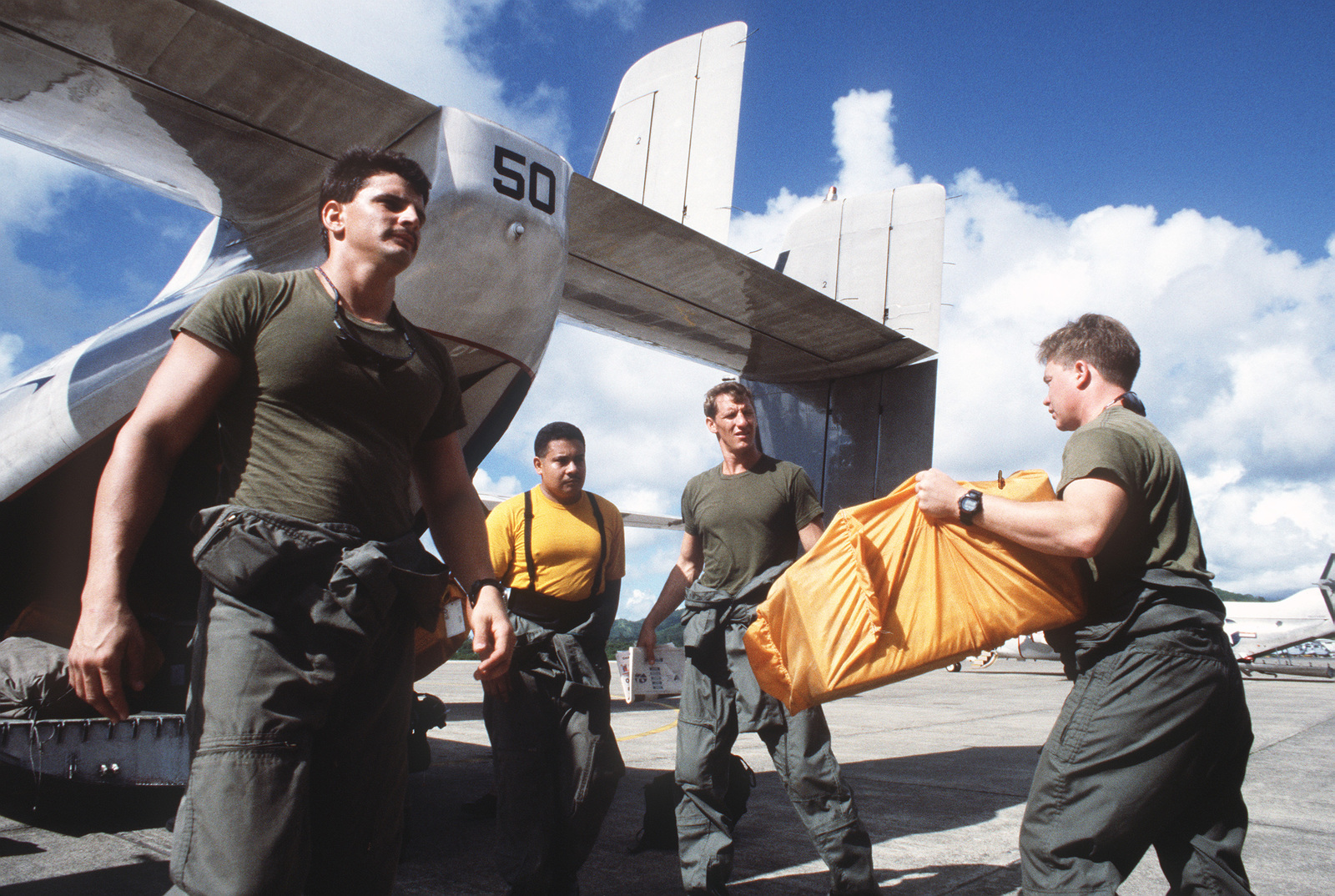 Members of SEAL Team 8 and Aviation Machinists Mate First
