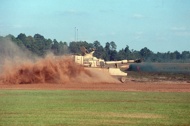An M109 Paladin kicks up the dust at the Multi-Purpose Range Complex (MPRC) during a training mission