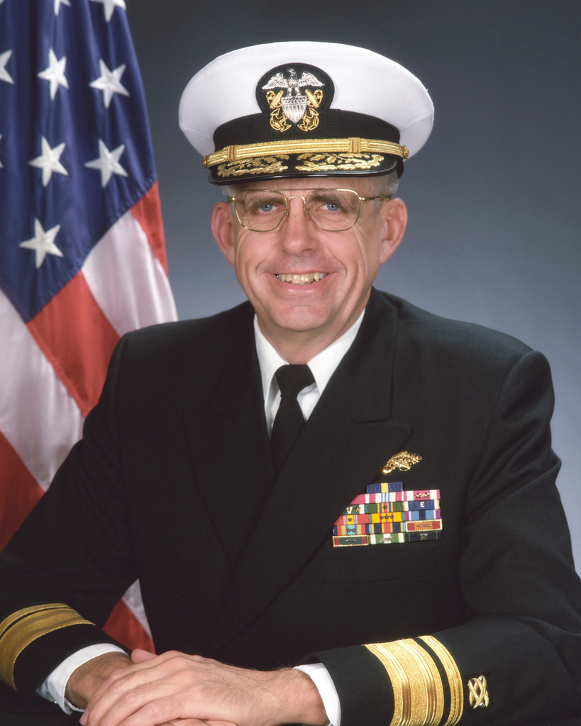 Vice Admiral Edward M. Straw, USN. (covered)