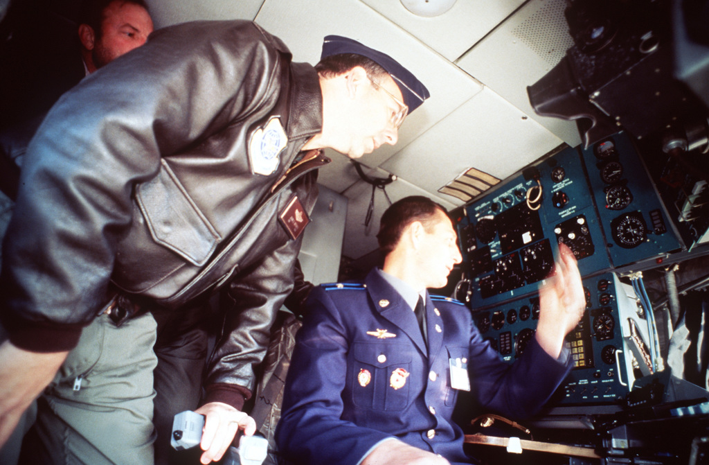 Colonel John Browser, director of 62nd Airlift Wing staff, McChord AFB, Wash., discusses the instrument panel at the navigator's station on the Russian IL-76 from Tver Military Transportation Air Base near Moscow Russia during an Open House at McChord AFB as part of Peacekeeper '95