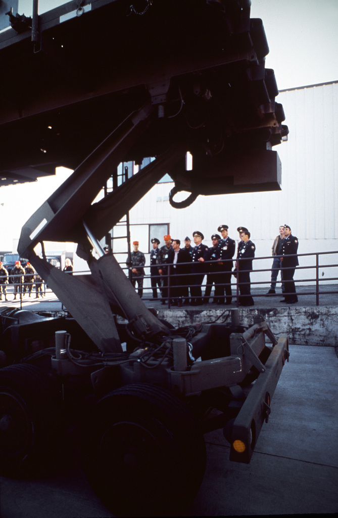 The crew of the Russian IL-76 transport, Tver Military Transportation Air Base located near Moscow Russia, watch as members of the 62nd Aerial Port Squadron, McChord AFB, Wash., demonstrate the capabilities of a K-Loader during exercise Peacekeeper '95