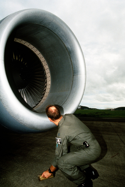 CAPT. Rick Poel, pilot from the 912th ARS Grand Forks ND, checks the engine intake blades for damage during preflight inspection before a refueling mission