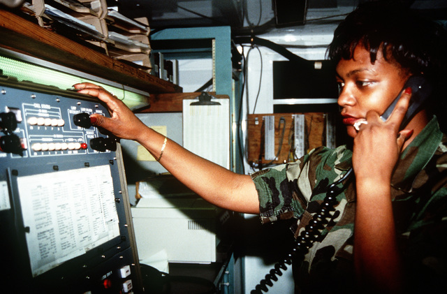 STAFF SGT. Charmaine Love from the 612 Air Communications Squadron, performs a test run on a Remote Call Service Position