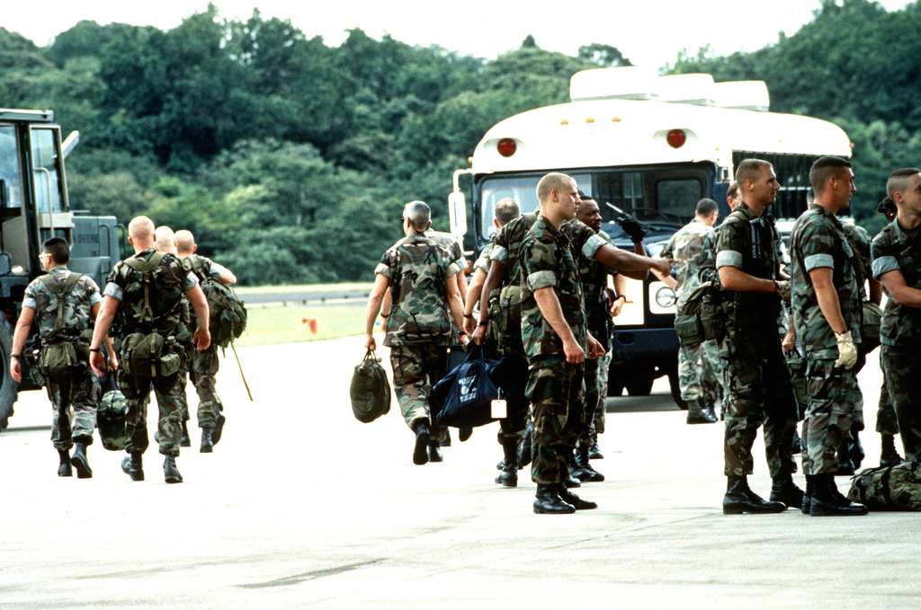 Marines from the Marine Air Combat Control Squadron-24, 4th MAW Dam-Neck, Virginia Beach VA., head to the passenger bus just after arriving on a C-5 cargo aircraft