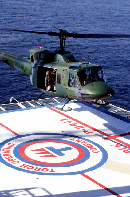 A UH-1 Iroquois helicopter from the 76th Rescue Flight, Vandenberg Air Force Base, California, successfully lands on Platform Irene. Platform Irene is an off shore oil platform located three miles off of the coast of Vandenberg AFB