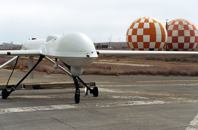 Right front view of the Navy's Predator Unmanned Aerial Vehicle (UAV) parked on the runway in preparation for a simulated Navy reconnaissance mission to be flown in conjunction with Command Carrier Group One (CVG-1). The Predator has a wingspan of 48.4 feet, a length of 26.7 feet and weighs approximately 1,500 pounds when fully fueled. Average speed is approximately 70 knots with a flight endurance of nearly 50 non-stop hours. The aircraft cost is about 3.2 million dollars and is operated by a joint service detachment