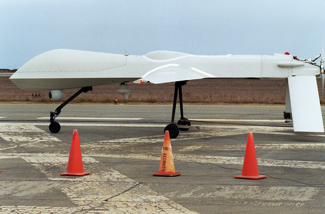 Left side view of the Navy's Predator Unmanned Aerial Vehicle (UAV) being fired up on the runway in preparation for testing with Carrier Group One (CVG-1). The Predator is capable of over 50 hours of non-stop flight. It has a wingspan of 48.4 feet, length of 26.7 feet and weighs approximately 1,500 pounds when fully fueled. Average speed is approximately 70 knots. Cost of the Predator is about 3.2 million dollars