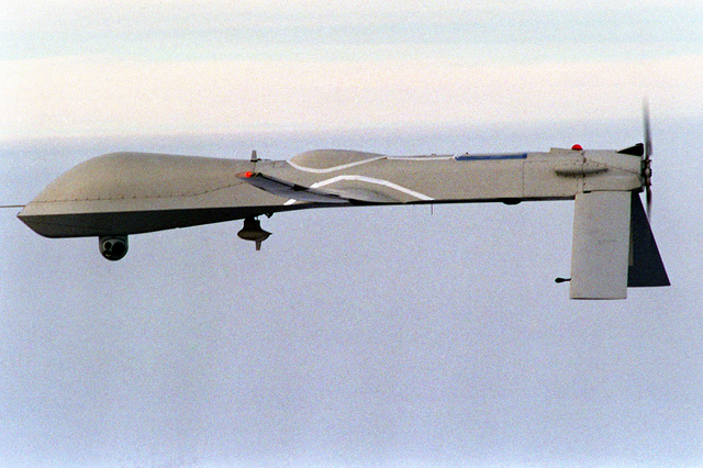 Left side view of the Navy's Predator Unmanned Aerial Vehicle (UAV) in-flight near San Nicholas Island. The Predator UAV has a wingspan of 48.4 feet, length of 26.7 feet and weighs approximately 1,500 pounds when fully fueled. Average speed is approximately 70 knots and its flight endurance is nearly 50 non-stop hours. Cost of the Predator is about 3.2 million dollars and is operated by a joint armed services detachment