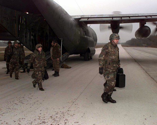 Members of the Joint Information Team, commanded by COL. Michael Perini, Langley AFB, Virginia, arrive at Tuzla AB, Bosnia-Herzegovina on board a C-130 from Ramstein AB, Germany. COL. Perini's team is tasked with managing hundreds of media personnel. C-130s from the 37th Airlift Squadron are flying into Tuzla in support of Operation Joint Endeavor
