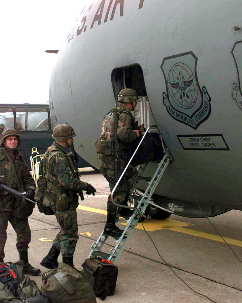 Members of the 3rd Corps Support Command and the 30th Medical Brigade, both from Weisbaden, Germany, board a C-141 Starlifter from the 437th Airlift Wing, Charleston Air Force Base, SC, bound for Tazar Airfield Hungary