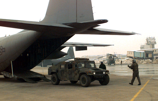 A High Mobility Multi-wheel Vehicle (HUMMV) is downloaded from a C-130 Hercules from the 37th Airlift Squadron, Ramstein AB, Germany, after landing in Sarajevo, Bosnia-Herzegovina. The vehicle will be used in support of Operation Joint Endeavor
