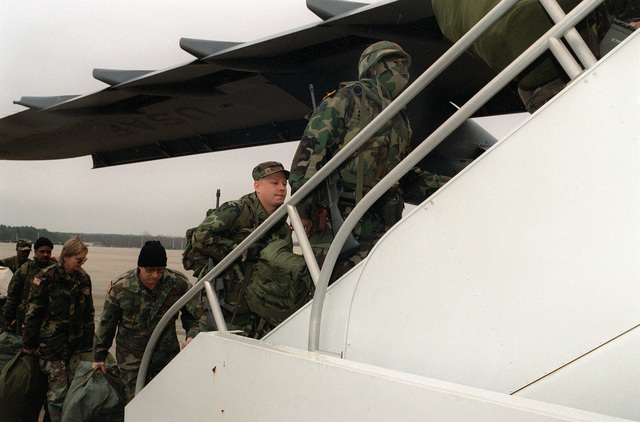 Members of the 23rd Aeromedical Evacuation Squadron board a Dover AFB, 436th Airlift Wing's C-5B on the Green Ramp at Pope AFB, N.C. on 18 Dec 1995. The 23rd Wing unit will fly first to Ramstein Air Base, Germany and then to Tuzla Air Base, Bosnia where they will establish a Mobile Aeromedical Staging Facility (MASF) in support of Operation Joint Endeavor