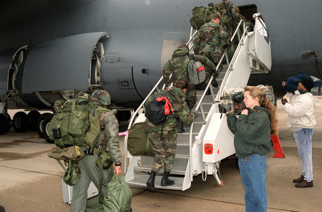 National television news from ABC News (right foreground) and CNN cover the deployment of the 23rd Aeromedical Evacuation Squadron, 23rd Wing from Pope AFB, N.C. bound for Ramstein Air Base, Germany and then to Tuzla Air Base, Bosnia where they will establish a Mobile Aeromedical Staging Facility (MASF) in support of Operation Joint Endeavor