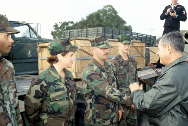 The CHIEF of Naval Operations, Admiral Mike Jeremy M. Boorda, thanks members of Mobile Construction Battalion One-Three-Three (NMCB-133) Seabees for their untiring efforts in preparing the battalion for deployment to Croatia and then on to Bosnia as part of Operation Joint Endeavor. From left to right equipment operators: unknown, EOCR Helen Fray, EO2 Joshua Turner, and EOCN Michael Woddin