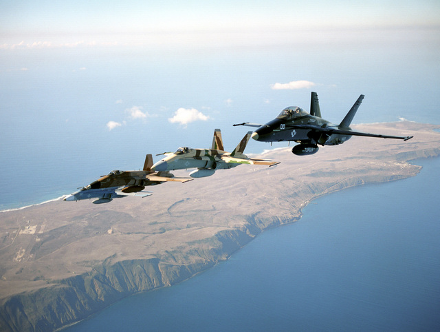 A four ship of F/A-18 Hornet from the TOPGUN school fly in echelon formation over San Clemente Island, California
