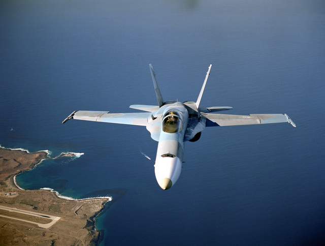 An F/A-18 Hornet from the TOPGUN school fly over San Clemente Island, California