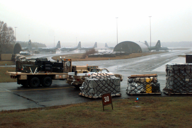 Vehicles and pallets wait in the marshaling yard at Ramstein AB, Germany, until they can be airlifted to Tuzla AB, Bosnia-Herzegovina, in support of Operation Joint Endeavor