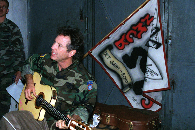 Country music singer Larry Gatlin visited the Seabees of Naval Mobile Construction Battalion One-Thirty-Three (NMCB-133) to do a special Christmas Day performance at a former Russian Army base scud missile magazine now converted to a 200-man bunk room in support of Operation Joint Endeavor, a peace keeping mission to Croatia