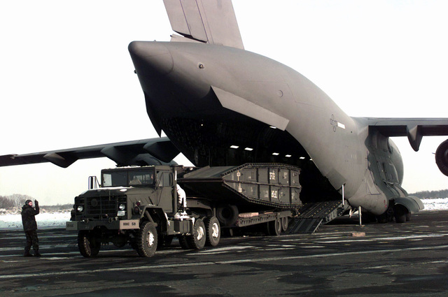 A M172A1 Mobile Bridge is offloaded from a C-17 Globemaster III. It is part of the mobile bridge installed by engineering units crossing the Sava River to move Implementation Forces (IFOR) assets into the theater of operations