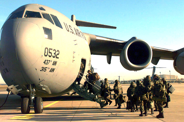 U.S. Army Personnel from Baumholder, Vilseck, and Bad Kreuznach, Germany board a C-17 Globemaster III from the 437th Airlift Wing, Charleston AFB, South Carolina. The troops are on their way to Tuzla AB, Bosnia-Herzegovina to provide support in Operation Joint Endeavor