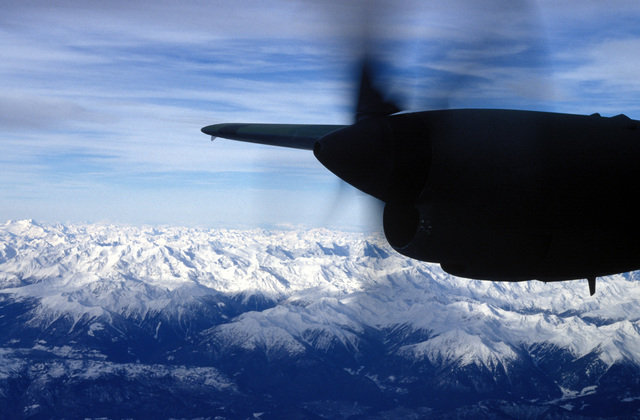 A C-130 flies over the Swiss Alps enroute to Sarajevo to deliver humanitarian aid to the besieged city