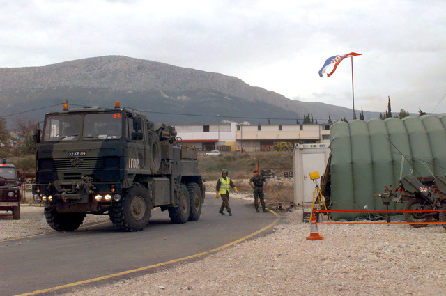 A Royal Army (British) Foden (6x6) Recovery Vehicle, with IFOR Markings, prepares to leave the road at a Royal Army (British) checkpoint in Split, Croatia, during Operation Joint Endeavor. Operation Joint Endeavor is a peacekeeping effort by a multinational Implementation Force (IFOR), comprised of NATO and non-NATO military forces, deployed to Bosnia in support of the Dayton Peace Accords