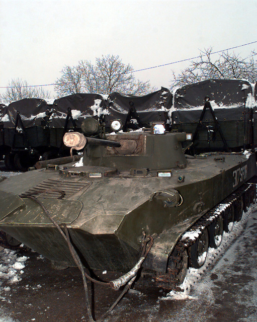 A Russian BMD-2 Airborne Combat Vehicle, with SFOR markings, is parked in front of several trailer units at the Russian Airborne Brigade in Tojsici, Bosnia-Herzegovina. This Brigade is in Bosnia in support of Operation Joint Guard. Operation Joint Guard is a peacekeeping effort by a multinational Implementation Force (IFOR), comprised of NATO and non-NATO military forces, deployed to Bosnia in support of the Dayton Peace Accords