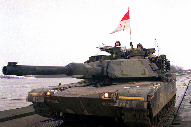 A U.S. Army M1A1 Abrams Tank from the 1ST Armored Division is one of the first vehicles to cross the newly constructed pontoon bridge over the Sava River. The bridge links Croatia to Bosnia-Herzegovina and was completed in support of Operation Joint Endeavor