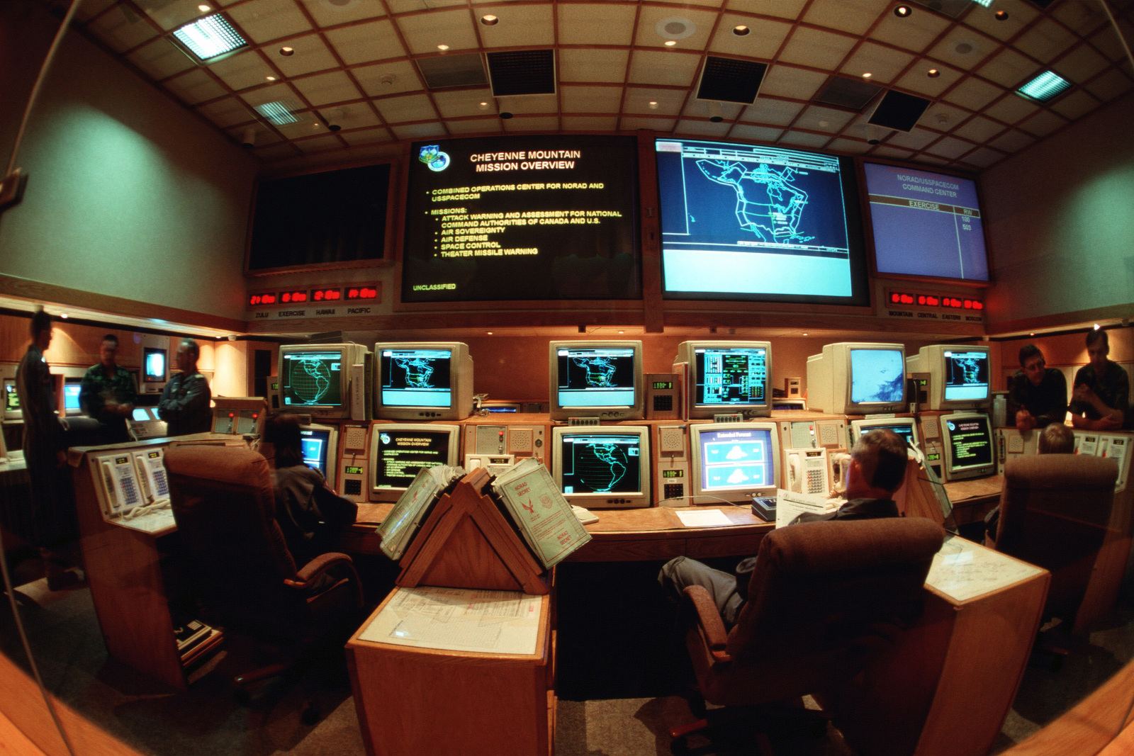 American and Canadian members, working in the North American Aerospace Defense Command's (NORAD) center inside of Cheyenne Mountain, Colorado, keep an eye on the sky looking for threats aimed at our continent. This image was used in the January 1996 issue of AIRMAN Magazine