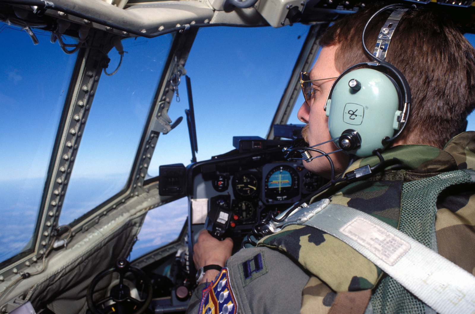 CAPT. Mark Sutherland looks for other air traffic while flying an airland mission to Sarajevo. CAPT. Sutherland is assigned to the 165th Airlift Squadron, Kentucky Air National Guard, Louisville, Ky