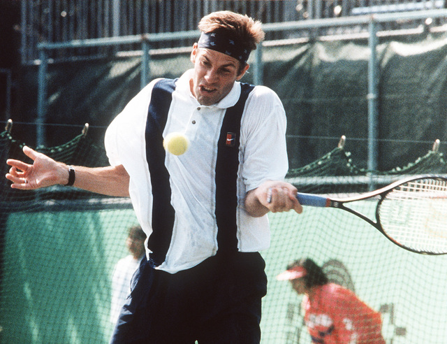 Military Photographer of the Year Winner 1996 Title: Tennis Tantrum Category: Sports Place: Honorable Mention Brief Description: A tennis player, racquet in hand, watches the ball as it is about to strike him in the middle of the chest. Exact Date Shot Unknown