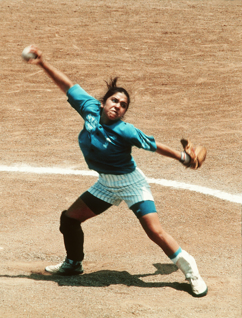 Military Photographer of the Year Winner 1996Title: The WhipCategory: SportsPlace: Honorable MentionBrief Description: A softball player puts all her energy into her windup to throw the ball. Exact Date Shot Unknown