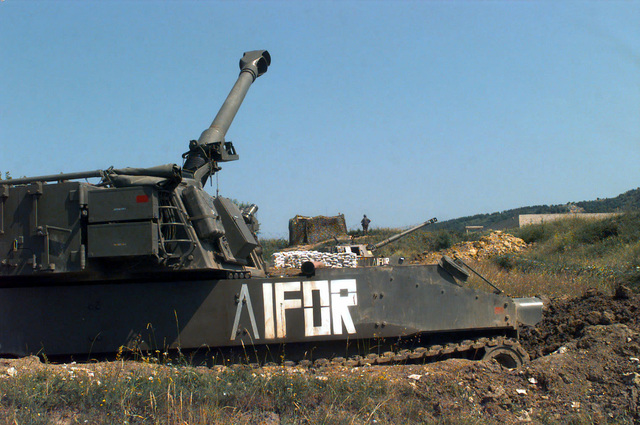 Two Italian Army OTO Melara 155mm M109L Self-propelled Howitzer, Batteria di Artiglieria, with IFOR markings are in position at Slatina Base, near Sarajevo, Bosnia-Herzegovina, in support of Operation Joint Endeavor. Operation Joint Endeavor is a peacekeeping effort by a multinational Implementation Force (IFOR), comprised of NATO and non-NATO military forces, deployed to Bosnia in support of the Dayton Peace Accords. M109L Self-propelled Howitzers in position at Slatina Base near Sarajevo, Bosnia-Herzegovina