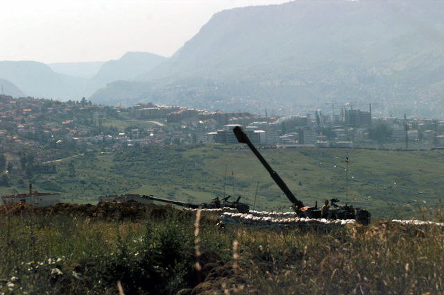 Two Italian Army OTO Melara 155mm M109L Self-propelled Howitzers, Batteria di Artiglieria, are in position at Slatina Base, near Sarajevo, Bosnia-Herzegovina, in support of Operation Joint Endeavor. Operation Joint Endeavor is a peacekeeping effort by a multinational Implementation Force (IFOR), comprised of NATO and non-NATO military forces, deployed to Bosnia in support of the Dayton Peace Accords. M109L Self-propelled Howitzers in position at Slatina Base near Sarajevo, Bosnia-Herzegovina