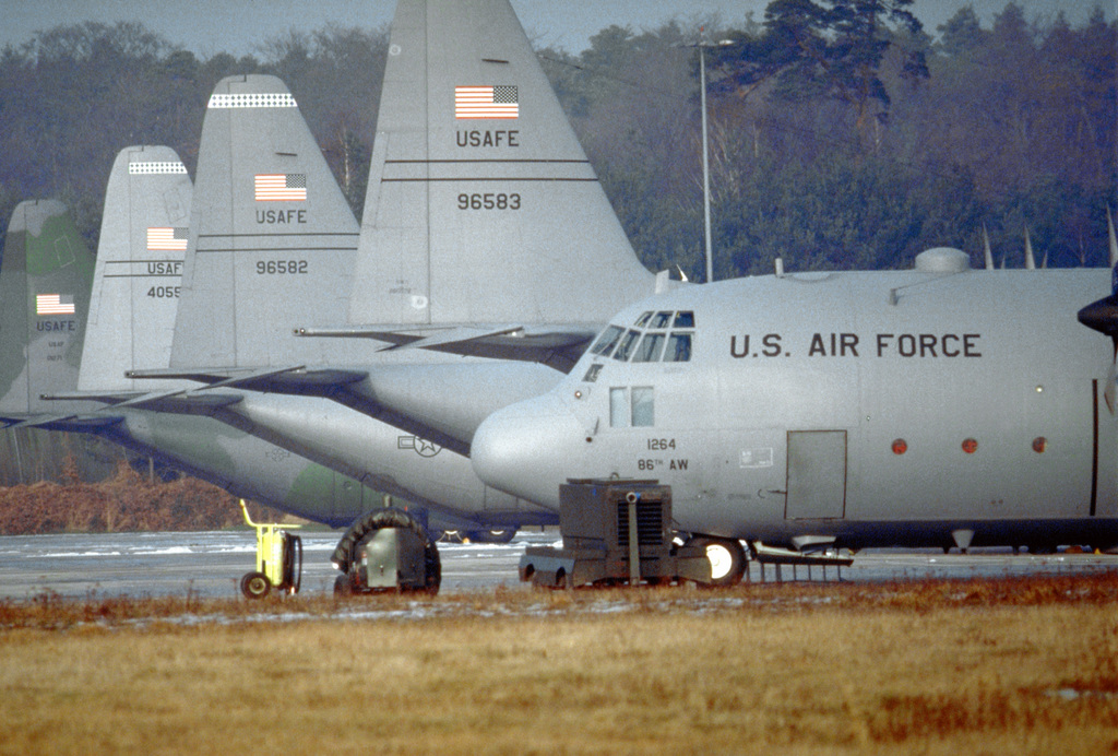 C-130 Hercules aircraft from the 37th Airlift Squadron are parked on the tarmac at Ramstein Air Base, Germany. The 37th flies missions into Bosnia in support of Operation Joint Endeavor