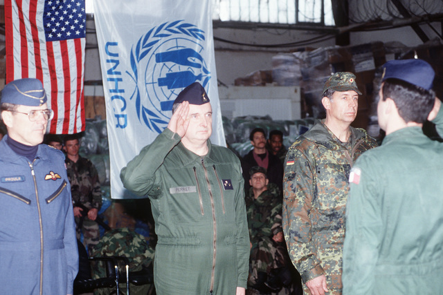 """During the Sarajevo Air Bridge Humanitarian Aid termination ceremony, the French Joint Air Operations Commander from Ancona, Italy salutes and reports """"Mission complete"""" to General-Division Perret, the French High Level Working Group (HLWG) representative. The last pallet of supplies has just been delivered. The longest humanitarian airlift in history is ending. During the past three and one half years the operation has provided 160,000 metric tons of supplies in 12,900 sorties involving 21 nations"""