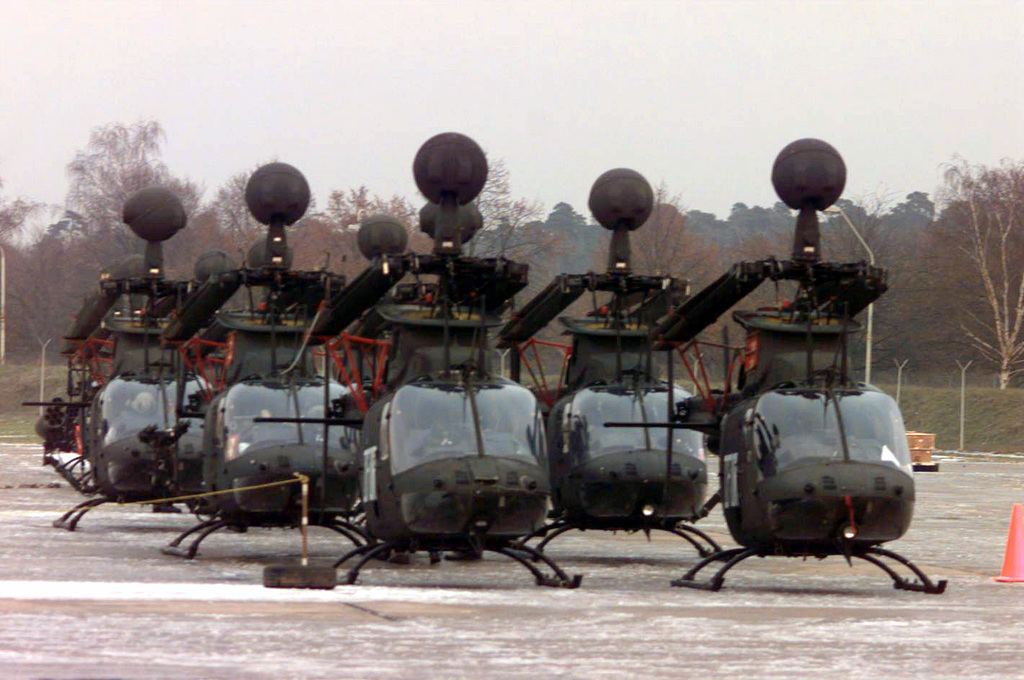 OH-58D helicopters line up on the flightline at Rhein Main AB, Germany in preparation of being loaded onto Air Force cargo aircraft which are headed to bases in support of Operation Joint Endeavor