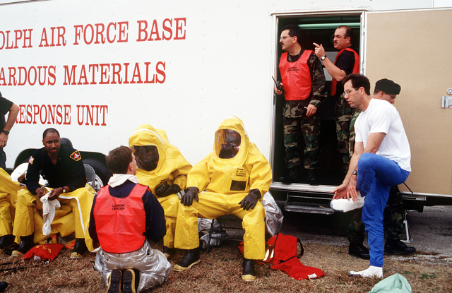 Members of the 12th Civil Engineer Squadron Fire Protection Flight practice emergency decontamination procedures during a major accident response exercise