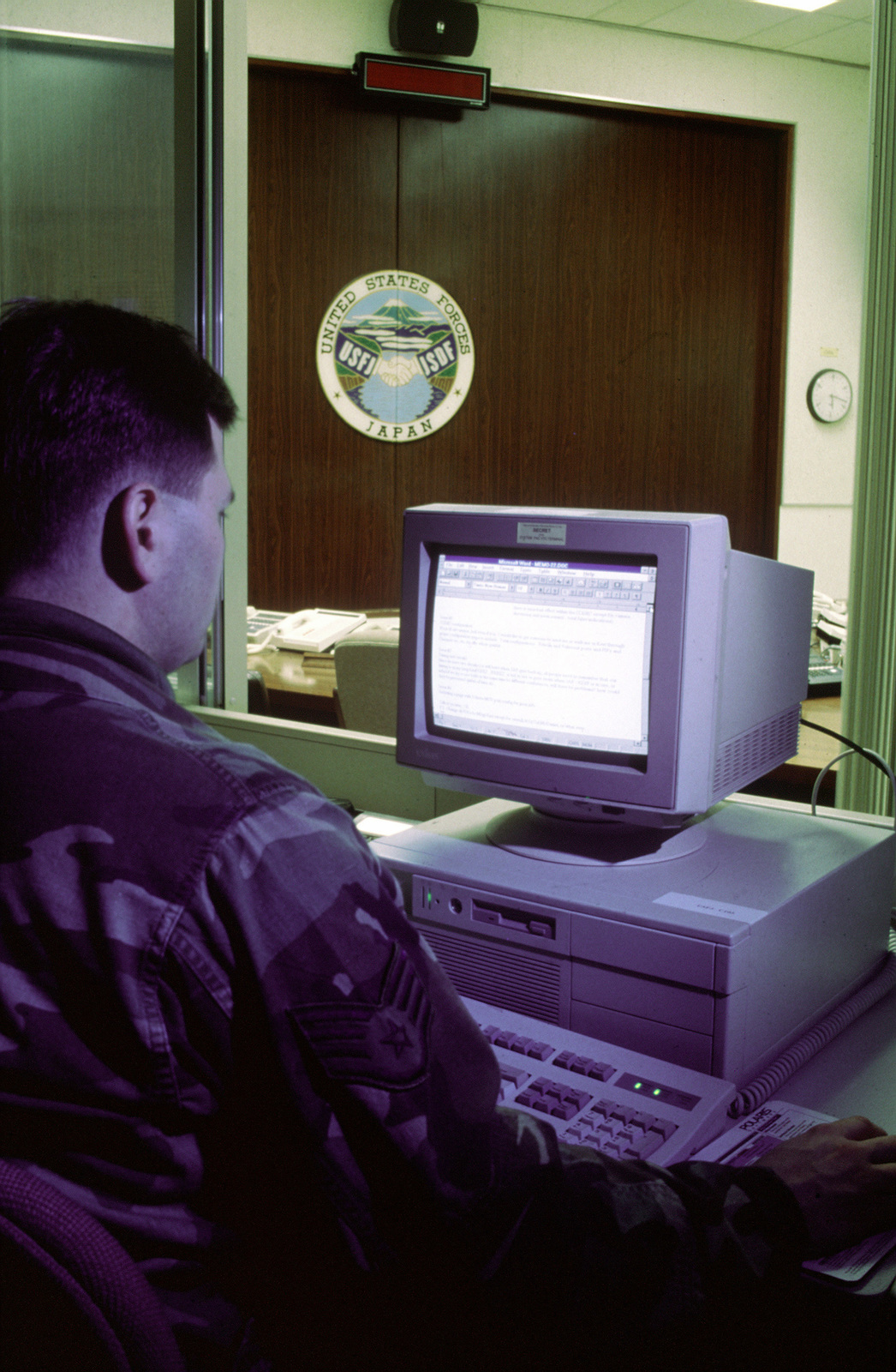 United States Air Force SSGT Issac D. Morrow checks his computer system in United States Forces Japan's (USFJ) Command Post at Yokota Air Base, Japan. SSGT Morrow and 4,000 other US military members are participating with Japan Self Defense Force (JSDF) members in KEEN EDGE '96, a joint/bilateral command post exercise from January 25 until February 2, 1996