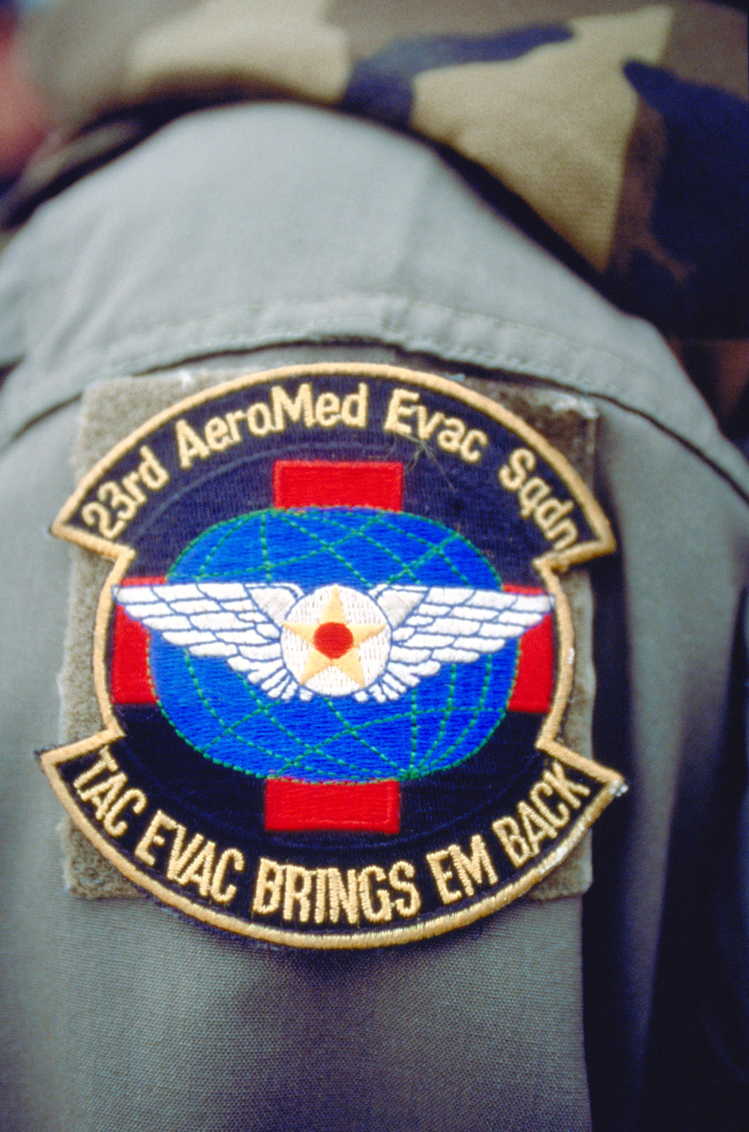 A close-up view of the unit patch for the 23rd Aero-Medical Evacuation Squadron, Pope Air Force Base, North Carolina, who provide 24 hour emergency medical support for Tuzla Air Base, Bosnia while deployed in support of Operation Joint Endeavor