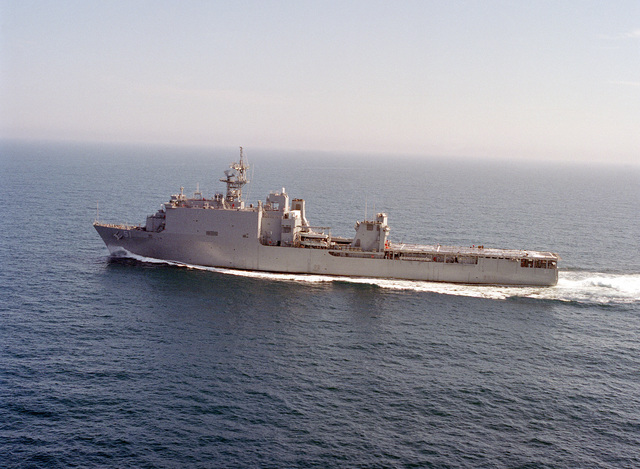 An aerial port beam view of the amphibious dock landing ship USS OAK HILL (LSD-51) underway during builder's sea trials