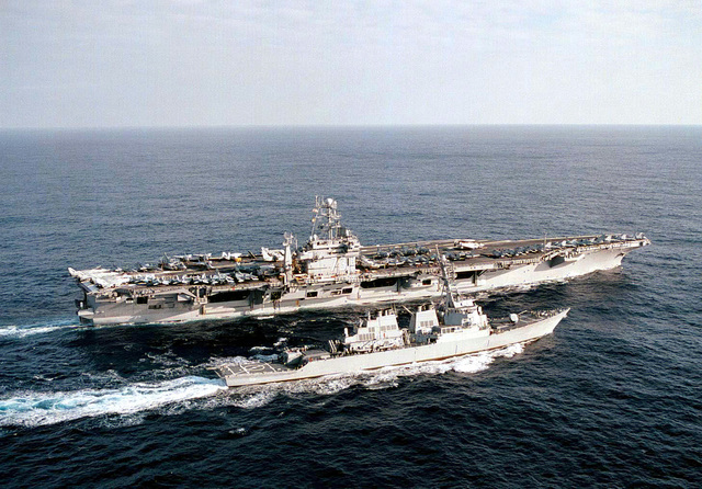 The USS George Washington (CVN-73) refuels the Arleigh Burke Class Guided Missile Destroyer, USS Stout (DDG-55) while transiting the Atlantic Ocean during Operation Joint Endeavor. This refueling mission marked the first time the USS Stout came alongside an aircraft carrier for underway replenishment