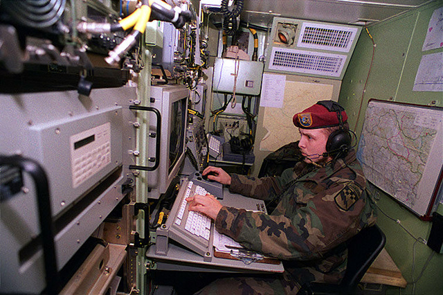 During Operation Joint Endeavor, SPECIALIST James Hoff, 319th Battalion, Fort Bragg, North Carolina, operates a Synthetic Aperture Radar Terminal that is receiving information from Joint STARS (Joint Surveillance Target Attack Radar System) located in Kaposvar, Hungary