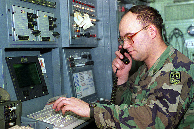 In support of Operation Joint Endeavor, STAFF Sergeant Lonnie Lowe, Switch Supervisor, monitors communication from an AN/TTC-39D/TS switching van, located on Kaposvar Airfield, Hungary