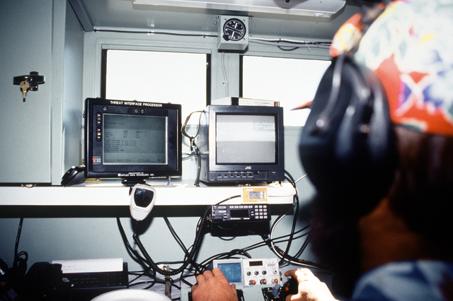 Mr. J.D. Williams, a Threat Operations Technician for Lockheed/Martin, tracks inbound British aircraft on the radar and video screens of the Universal Anti-Aircraft Artillery (A3) Simulator. Exact Date Shot Unknown