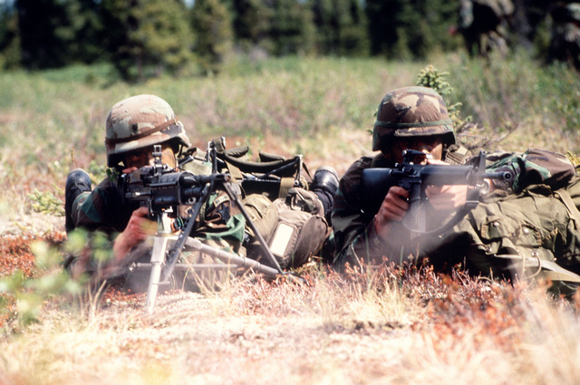 SPECIALIST Jeff Keith and Private 2nd Class Louis Chamorrow, A Company, 117th Infantry Regiment, Fort Wainwright, Alaska, guard their position during an air assault. Exact Date Shot Unknown