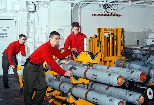 """Aviation Ordnancemen move AIM-120 Advanced Medium Range Air-to-Air Missiles (AMRAAM) in weapons magazines on board the U.S. Navy nuclear powered aircraft carrier USS George Washington (CVN 73). USS George Washington, under the command of CAPT Malcolm P. Branch departed its homeport of Norfolk, Virginia, on January 26 for a six month deployment to the Mediterranean Sea. While there, the """"Spirit of Freedom"""" will patrol the Adriatic Sea off the coast of Bosnia in support of NATO peace keeping Operation Joint Endeavor"""