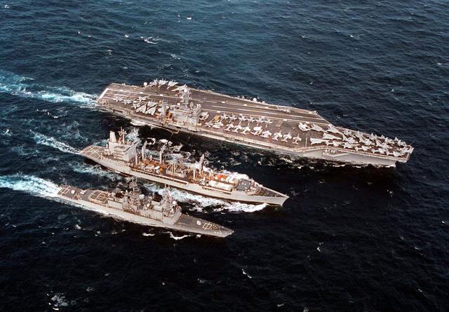 The Cimarron Class fleet oiler, USS Merrimack (AO-179), provides simultaneous replenishment with the Spruance Class Destroyer, USS Arthur W. Radford (DD-968), and the USS George Washington (CVN-73), during Operation Joint Endeavor